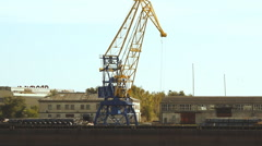 Crane in the port moves loads Stock Footage