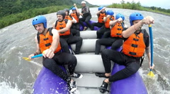 Tourist group whitewater rafting real deal, model released high-quality video Stock Footage