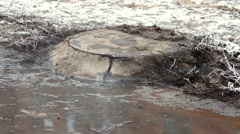 Manhole's accident on street , water flows over the road from the sewer Stock Footage