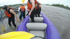 Ending whitewater rafting tour with tourists disembarking, on board mounted Stock Footage
