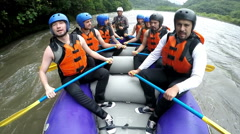 Whitewater rafting team unites their paddles as a sign of success, slow motion Stock Footage
