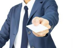 Businessman in Blue Suit Show Business Card or White Card in 45 Degree View I Stock Photos