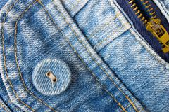 Jeans Button Bottom Left Corner With Part of Pocket and Zip - stock photo