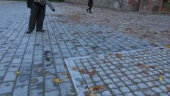 Worker  with leaf blowers clean up autumn leaves from street Stock Footage