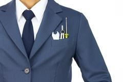 Businessman in Blue Suit with Wrench and Dividers and Screwdriver in Pocket I - stock photo