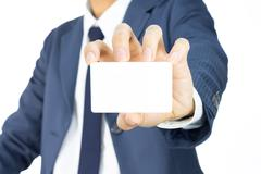 Businessman Hold Business Card or White Card Isolated on White Background - stock photo