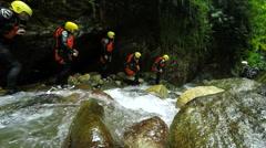 Group of tourists exploring Ecuadorian canyon in Llanganates national park, slow - stock footage