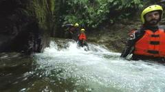Group of tourists exploring Ecuadorian canyon in Llanganates national park, slow Stock Footage