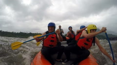 Team of seven people whitewater rafting Onboard camera - stock footage