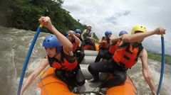 Team of seven people whitewater rafting Onboard camera Stock Footage