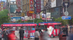 Timelapse crowded sidewalk shopping district neon sign ad Shanghai asian life  Arkistovideo