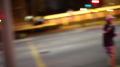 Evening traffic with headlights through intersection Stock Footage