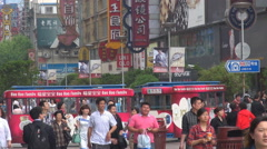 Crowded commercial road Shanghai downtown neon sign pedestrian people enjoy walk Stock Footage