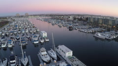 Flying backwards Aerial of boats in the Marina at Sunset #09 Stock Footage