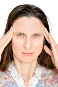 Woman with Headache - stock photo