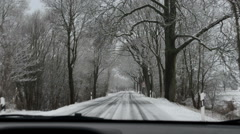 Driving along dangerous winterly road Stock Footage