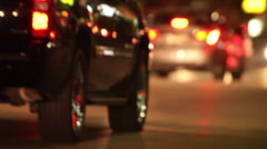 evening traffic with headlights through intersection - stock footage