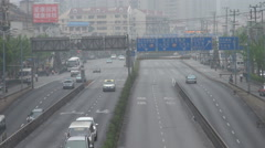 Closeup busy freeway Shanghai downtown highway infrastructure smog pollution day Stock Footage