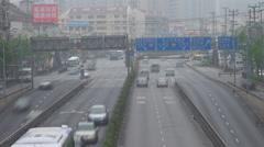 Timelapse traffic street freeway Shanghai multiple lane car pass people travel   - stock footage