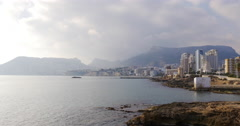 Stock Video Footage of panoramic view on cozy town calpe 4k sunny day