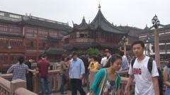 Tourist people visit traditional building Shanghai old town take photo landmark  Stock Footage