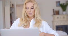Happy Blond Woman Using her Laptop Computer Stock Footage