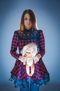 Girl of European appearance in klechatom dress holding a doll on Kuvituskuvat