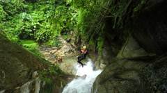 Young tourist men on zip line in Ecuadorian canyoning experience, Llanganates Stock Footage