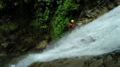 Tourist descent a huge waterfall, footage, model released, static camera - stock footage