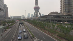 Oriental Pearl Tower traffic street freeway financial district commuter travel  Stock Footage