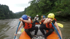 Senior and adult men rowing on whitewater rafting boat experience, onboard - stock footage