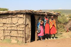Masai Women standing outside their home at daytime Stock Photos