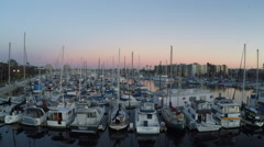 Aerial dolly across sailboats in the Marina at Sunset #05 Stock Footage