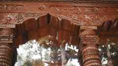 Nepal Peace carving on temple dolly Stock Footage
