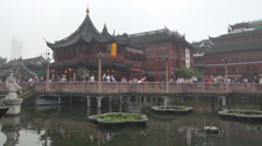 Tourist people visit Yuyuan Garden Chinese emblem Shanghai old town day iconic Stock Footage