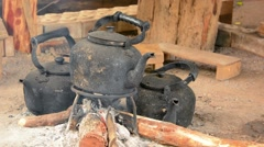 FullHD video - Blackened Tea Kettles over the Fire Stock Footage