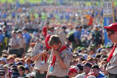 Boy Scouts talking at meeting - stock photo