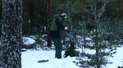 Sound engineer records the sound of footsteps in the snow for a documentary film - stock footage