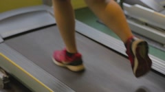 Low angle - closeup womens shoes running on treadmill Stock Footage