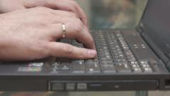 Man typing on old laptop Stock Footage