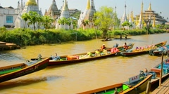 INLE LAKE, MYANMAR - CIRCA JAN 2014: Buddhist temple on the bank of the canal Stock Footage