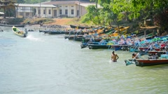 INLE LAKE, MYANMAR - CIRCA JAN 2014: Boaters are washed in the river near the - stock footage