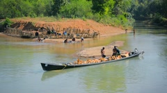 INLE LAKE, MYANMAR - CIRCA JAN 2014: Locals loading river sand in a boat Stock Footage