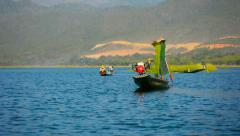 INLE LAKE, MYANMAR - CIRCA JAN 2014: Fishing with a network and motorboat. Stock Footage