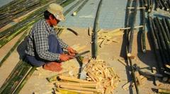 INLE LAKE, MYANMAR - CIRCA JAN 2014: Rough handling timber of bamboo Stock Footage