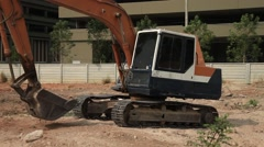 Excavator on a construction site equates land clearing a building site. Stock Footage