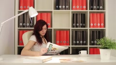 Business woman reading a newspaper Stock Footage