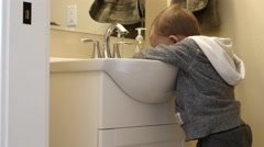 Little boy washing his hands in the bathroom Stock Footage