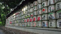 Wall of Decorate Sake Barrels At The Meiji Jingu Shrine Zoom Out Stock Footage