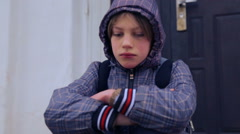 Caucasian boy near the building of the village school. Stock Footage